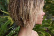 13 a short choppy bob with bangs and a slight balayage is a chic modern idea to rock