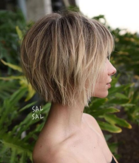 a short choppy bob with bangs and a slight balayage is a chic modern idea to rock