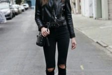 13 a total black look with ripped skinnies, a black cropped jacket, boots and a bag