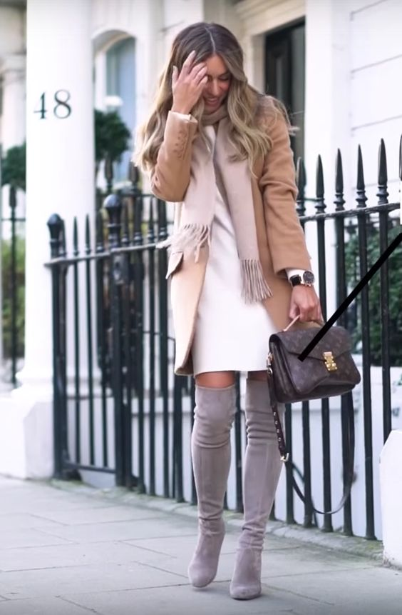 a white dress, grey suede tall boots, a blush scarf and a camel coat plus a comfy bag