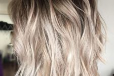 13 ashy blonde balayage with root fade on a shaggy bob is an edgy idea