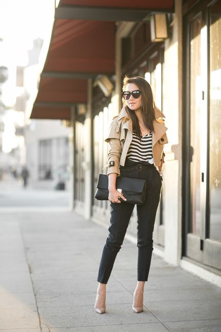 black pants, nude shoes, a striped tee, a cropped tan trench and a black clutch