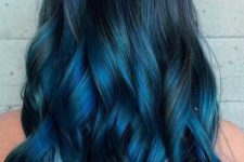 13 long black hair highlighted with indigo into teal balayage and with chic waves