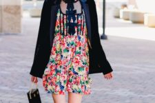 14 a colorful floral mini dress, a black velvet blazer, black shoes and a bag