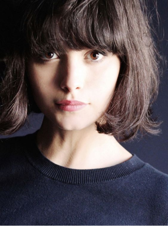 a short layered bob with long bangs is a 70s inspired option, which is popular now