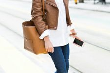 14 a white shirt, a cropped brown jacket, blue skinnies, brown booties and a bag