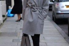 14 black cropped pants, black heels, a grey coat with a sash and a black velvet hat for an elegant feel