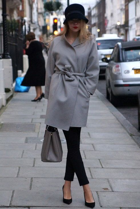 black cropped pants, black heels, a grey coat with a sash and a black velvet hat for an elegant feel