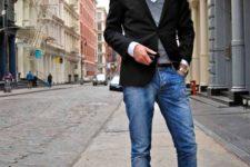 14 blue denim, black boots, a white shirt, a grey waistcoat, a black blazer for a chic smart casual feel