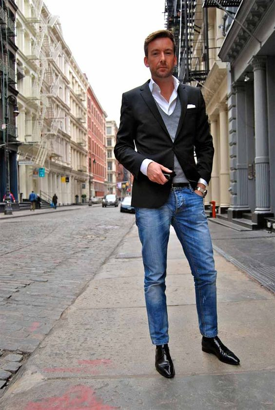 blue denim, black boots, a white shirt, a grey waistcoat, a black blazer for a chic smart casual feel