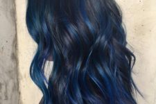 14 make your black hair stand out with blue balayage of some deep and saturated shade