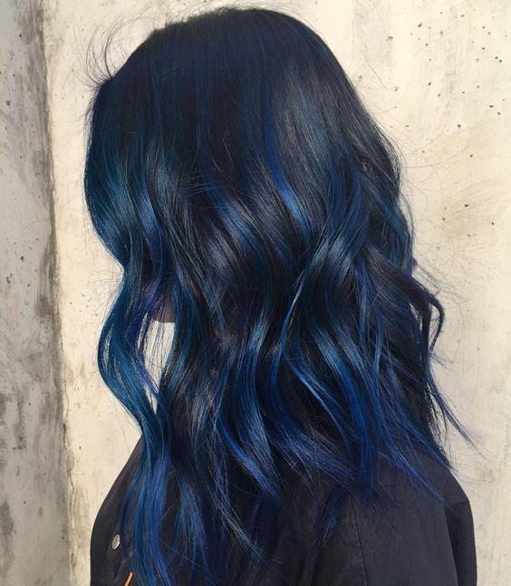 make your black hair stand out with blue balayage of some deep and saturated shade