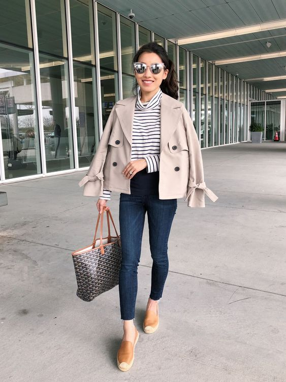 navy skinnies, tan slipons, a striped top, a grey cropped trench for a cool look