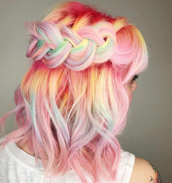 pink hair with rainbow coloring is a bold idea to rock, accent your hair with a braid