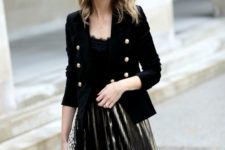 15 a chic look with a metlalic pleated skirt, a black lace top, a black velvet blazer with gold buttons