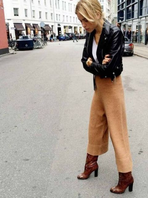 a white tee, cropped culottes, a black cropped leather jacket anf brown boots