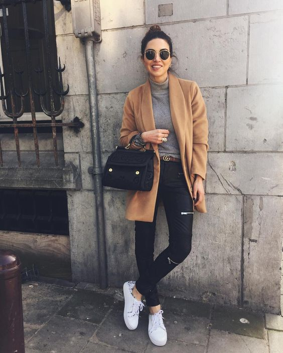 black leather pants, white sneakers, a grey turtleneck, a camel short coat for a casual feel