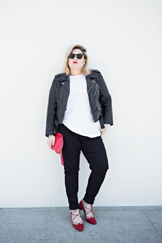 black pants, a white tee, a black leather jacket, red strappy shoes
