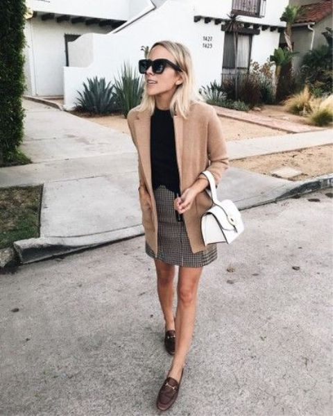 brown moccasins, a tweed mini skirt, a black tee, a tan blazer and a white bag