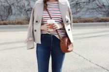 15 navy skinnies, a striped colorful top, brown flats and a bag, a grey cropped trench
