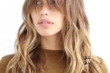 16 a long lyered haircut with a light ombre and long bangs plus messy waves