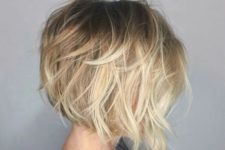 16 a short angled bob with a dark root and a shaggy touch looks very dimensional