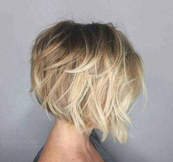 short angled bob blonde hair picture of a short angled bob with a dark root and a