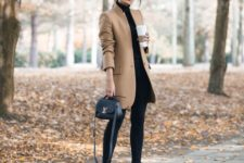 16 black skinnies and tall boots, a black turtleneck and a short camel coat for a touch of color