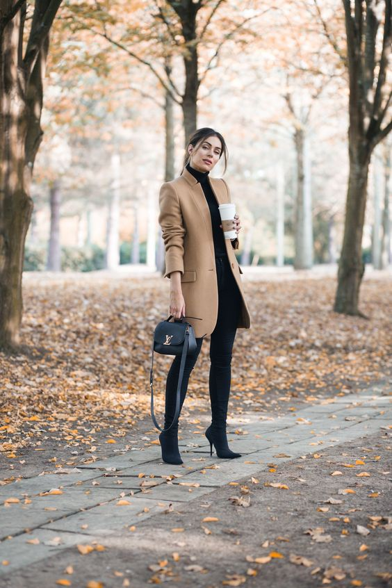 black skinnies and tall boots, a black turtleneck and a short camel coat for a touch of color