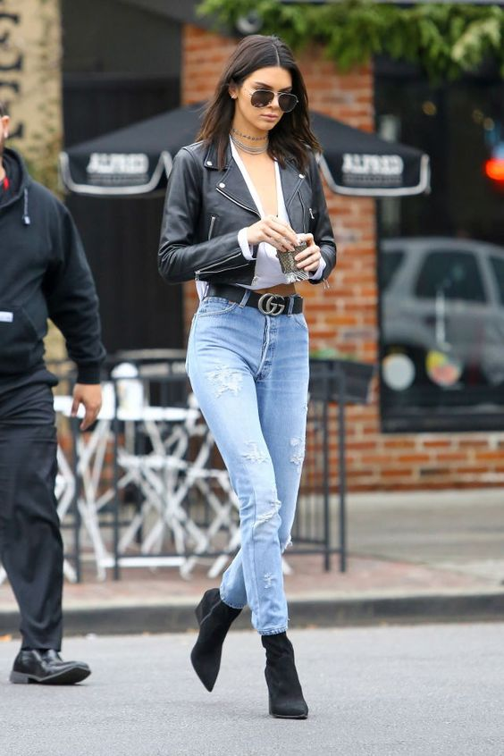 Picture Of blue high waisted skinnies, black boots, a white top, a black  cropped leather jacket