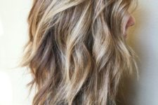 16 medium length haircut with a darker root for a wow look and a texture
