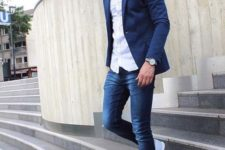 16 navy jeans, a white shirt, a navy blazer and light blue sneakers for a smart casual look