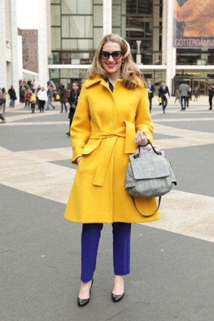 purple pants, black shoes, a grey bag and a mustard coat for a super bold fall look