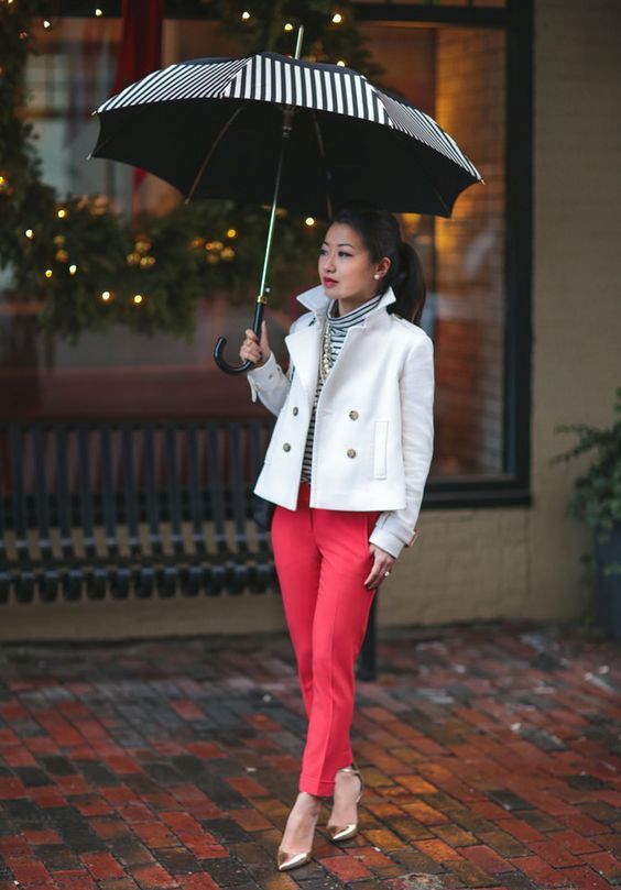 red pants, silver shoes, a striped turtleneck and a white cropped trench
