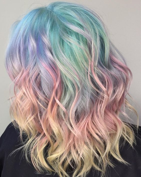 trendy medium-length hair with rainbow balayage and messy waves to stand out