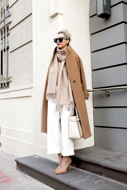 white culottes, a neutral scarf, neutral shoes and a camel coat plus a white bag for work