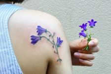 Artistic bluebell flower tattoo on the shoulder
