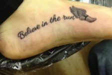 Believe in the run tattoo with a wing on the foot