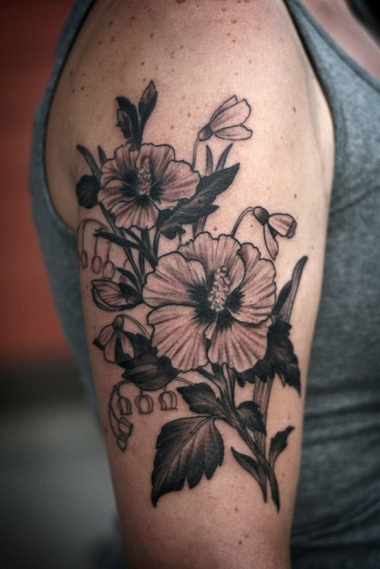 Big floral tattoo on the arm