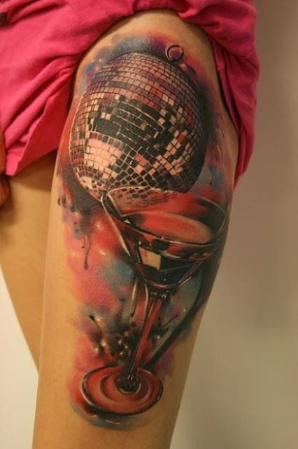 Big tattoo with disco ball and cocktail glass