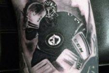 Black and white hockey player tattoo