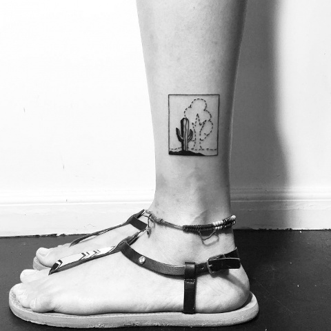 Black and white tattoo on the ankle