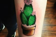 Cactus and pink flowers tattoo idea