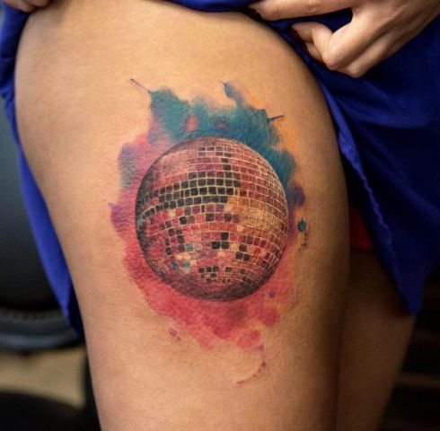 Colorful disco ball tattoo on the leg