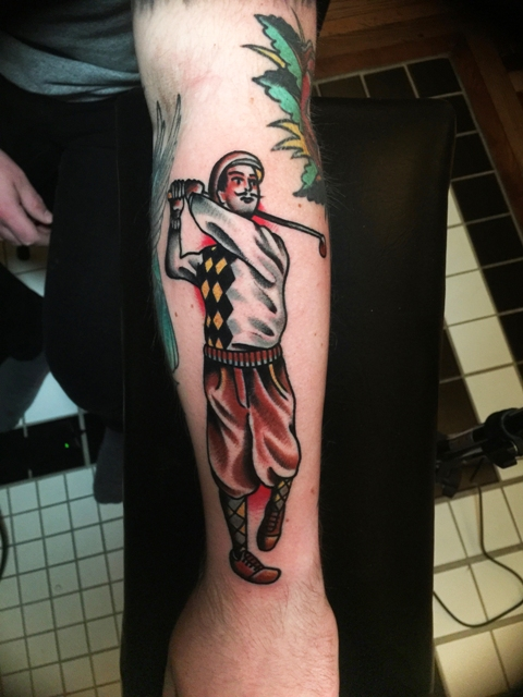 Colorful retro styled tattoo on the forearm