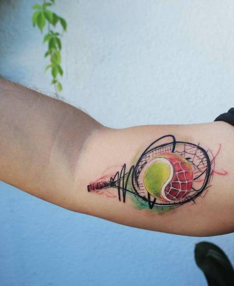 Colorful tattoo on the biceps