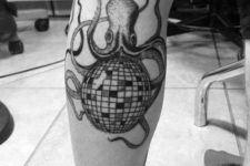 Disco ball and octopus tattoo on the leg