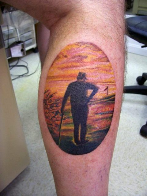 Golf player and sunset tattoo on the leg