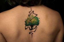 Green tattoo on the back