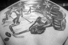 Hockey game tattoo on the back